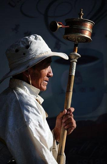 Praying Wheel and elder Tibetan pilgrim.jpg